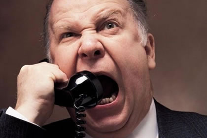 Man yelling into telephone